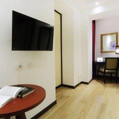 Отель IG-Suites удобства в номере
