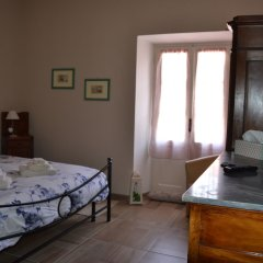 Отель Casa Nina B&B Боргомаро в номере