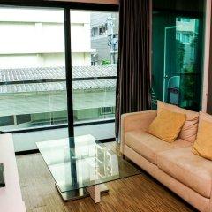 Апартаменты Sixty Six Pattaya Beach Road Apartment Паттайя комната для гостей фото 4