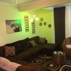 Отель Abacus Jamaica the Zana Suite комната для гостей