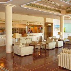 Отель Aegean Village Hotel Греция, Мастичари - отзывы, цены и фото номеров - забронировать отель Aegean Village Hotel онлайн интерьер отеля