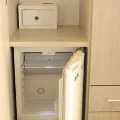 Hotel 4 Stagioni Риччоне сейф в номере