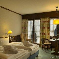 Отель HUUS Gstaad Швейцария, Занен - отзывы, цены и фото номеров - забронировать отель HUUS Gstaad онлайн комната для гостей фото 3