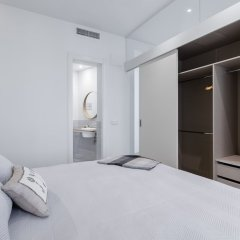 Апартаменты Puerta Toledo Apartment by FlatSweethome комната для гостей
