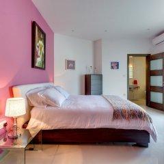 Отель Luxury 2 Bedroom Penthouse in St Julians Мальта, Сан Джулианс - отзывы, цены и фото номеров - забронировать отель Luxury 2 Bedroom Penthouse in St Julians онлайн комната для гостей