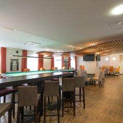 Гостиница AZIMUT Hotel FREESTYLE Rosa Khutor в Эсто-Садке - забронировать гостиницу AZIMUT Hotel FREESTYLE Rosa Khutor, цены и фото номеров Эсто-Садок гостиничный бар