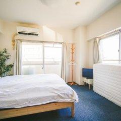 Апартаменты Hakata Apartment Хаката комната для гостей фото 4