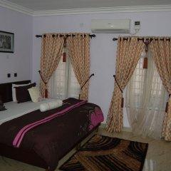 Отель Nue-Crest Hotels And Suites Нигерия, Энугу - отзывы, цены и фото номеров - забронировать отель Nue-Crest Hotels And Suites онлайн комната для гостей фото 2