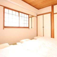 Отель AMP FLAT Nishijin5 Фукуока комната для гостей фото 2