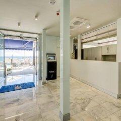 Отель Astuy Apartamentos Испания, Арнуэро - отзывы, цены и фото номеров - забронировать отель Astuy Apartamentos онлайн интерьер отеля