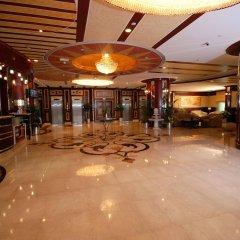 Отель Al Bustan Tower Hotel Suites ОАЭ, Шарджа - отзывы, цены и фото номеров - забронировать отель Al Bustan Tower Hotel Suites онлайн интерьер отеля
