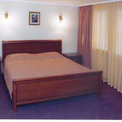 Гостиница Европейский комната для гостей фото 4