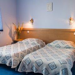 WM Hotel System Sp. z o.o. комната для гостей