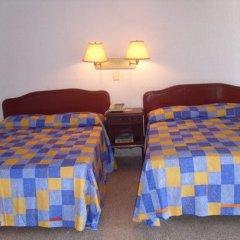 Отель Caleta Beach Resort Мексика, Акапулько - отзывы, цены и фото номеров - забронировать отель Caleta Beach Resort онлайн комната для гостей фото 3