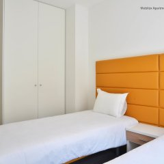 Апартаменты Mobilux Apartments Lisbon комната для гостей фото 5
