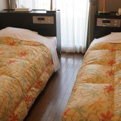 Отель Shiki no Mori Япония, Минамиогуни - отзывы, цены и фото номеров - забронировать отель Shiki no Mori онлайн сейф в номере