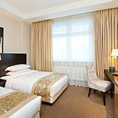 Гринвуд Отель комната для гостей фото 6