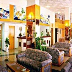 Kapetanios Bay Hotel интерьер отеля