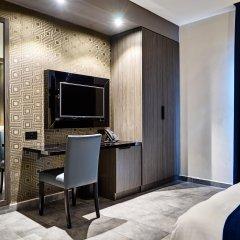 Отель The District Hotel Мальта, Сан Джулианс - 1 отзыв об отеле, цены и фото номеров - забронировать отель The District Hotel онлайн удобства в номере фото 2