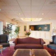 Отель extend a suites интерьер отеля фото 3