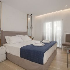 Апартаменты Lovely apartment close to Acropolis by GHH Афины комната для гостей фото 3