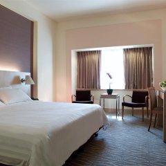 Отель Parkroyal On Beach Road Сингапур комната для гостей фото 2