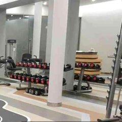 Отель Crest Resort & Pool Villas фитнесс-зал фото 4