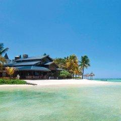 Отель Heritage Le Telfair Golf & Wellness Resort пляж