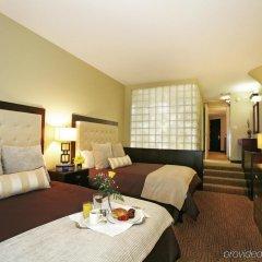 Отель Atheneum Suite Hotel США, Детройт - отзывы, цены и фото номеров - забронировать отель Atheneum Suite Hotel онлайн комната для гостей фото 2