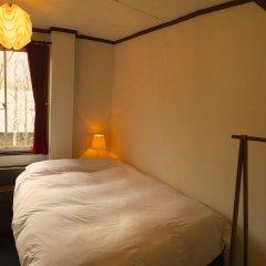 Отель Kamoshika Views Хакуба комната для гостей