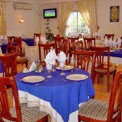 Отель Hilary Hotel Республика Конго, Пойнт-Нуар - отзывы, цены и фото номеров - забронировать отель Hilary Hotel онлайн помещение для мероприятий