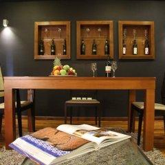 Отель Andromeda Suites and Apartments Греция, Афины - отзывы, цены и фото номеров - забронировать отель Andromeda Suites and Apartments онлайн гостиничный бар