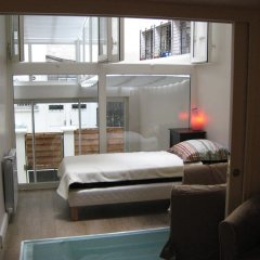 Отель Montgolfier Apartment Франция, Париж - отзывы, цены и фото номеров - забронировать отель Montgolfier Apartment онлайн комната для гостей фото 3