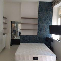 Отель Milestay Champs Elysées Париж комната для гостей