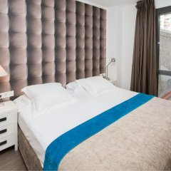 Апартаменты Cosmo Apartments Consell de Cent комната для гостей фото 3