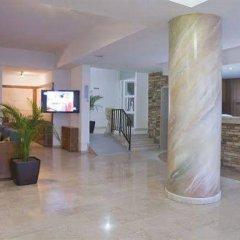 Отель Trizas Hotel Apartments Кипр, Протарас - отзывы, цены и фото номеров - забронировать отель Trizas Hotel Apartments онлайн интерьер отеля фото 2