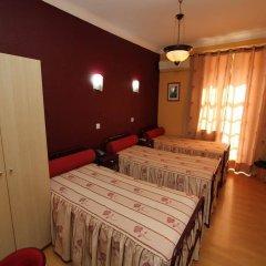 Отель Pensao Praca Da Figueira Лиссабон комната для гостей фото 5