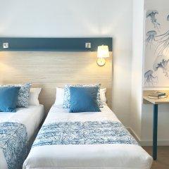 Отель Salou Beach by Pierre & Vacances Испания, Салоу - отзывы, цены и фото номеров - забронировать отель Salou Beach by Pierre & Vacances онлайн комната для гостей фото 3