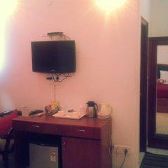 Отель Malik Continental Индия, Нью-Дели - отзывы, цены и фото номеров - забронировать отель Malik Continental онлайн удобства в номере фото 2