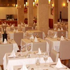 Hotel Santo Tomas Эс-Мигхорн-Гран питание фото 2