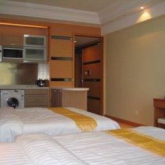 Апартаменты She & He Service Apartment - Huifeng комната для гостей фото 3