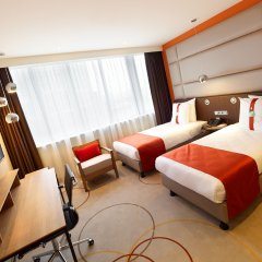Отель Holiday Inn Amsterdam - Arena Towers комната для гостей
