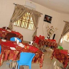 Отель Mikagn Hotel And Suites Нигерия, Ибадан - отзывы, цены и фото номеров - забронировать отель Mikagn Hotel And Suites онлайн питание фото 2