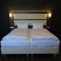 Отель PLAZA Inn Hamburg Moorfleet Германия, Гамбург - 1 отзыв об отеле, цены и фото номеров - забронировать отель PLAZA Inn Hamburg Moorfleet онлайн комната для гостей фото 4