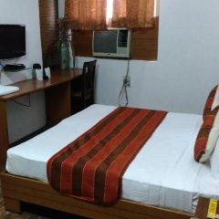 Отель Sarthak Palace Индия, Нью-Дели - отзывы, цены и фото номеров - забронировать отель Sarthak Palace онлайн комната для гостей фото 4