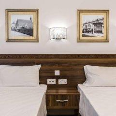 Отель Slimiza Suites Слима комната для гостей