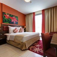 Abidos Hotel Apartment, Dubailand комната для гостей фото 5
