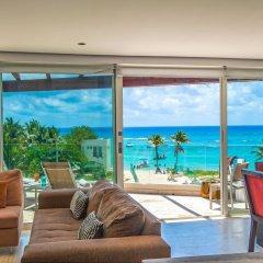 The Elements Oceanfront & Beachside Condo Hotel Плая-дель-Кармен комната для гостей фото 3