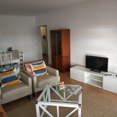 Апартаменты Lila Beach Apartment Понта-Делгада комната для гостей фото 2