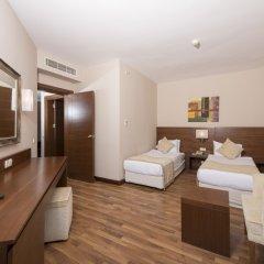 Отель Roma Beach Resort & Spa Сиде сейф в номере